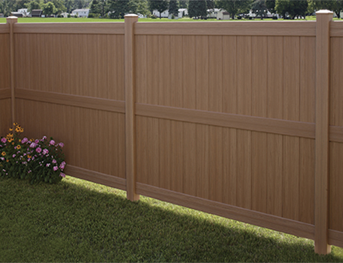 Galveston faux-wood textured vinyl fence in brown