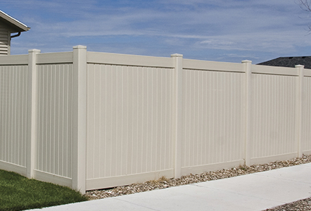 Classic vinyl privacy fence in almond