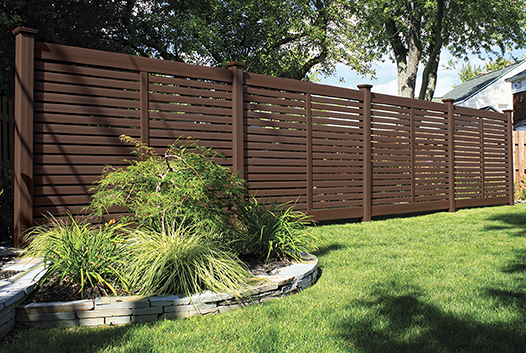 Textured Vinyl Privacy Fence with landscaping