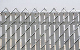 flat noodle link privacy slats in a chain link fence