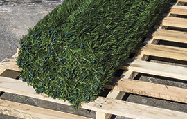 fake hedge fence slats in a roll