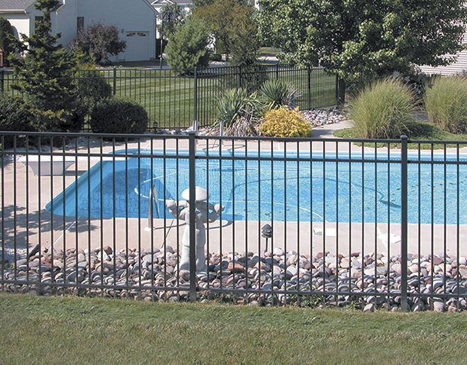 ovation aluminum pool fence in a yard with a pool