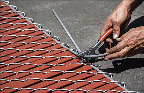 securing slats in factory inserted chain link mesh